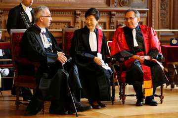 South Korean President Park Geun-hye reacts after she was presented with the insignia of Doctor Honoris Causa during a ceremony at La Sorbonne university in Paris