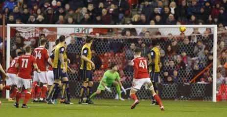 Nottingham Forest's Ben Osborn scores their first goal from a free kick