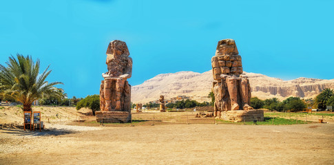 Wall Murals Egypt Egypt. Luxor. The Colossi of Memnon - two massive stone statues of Pharaoh Amenhotep III