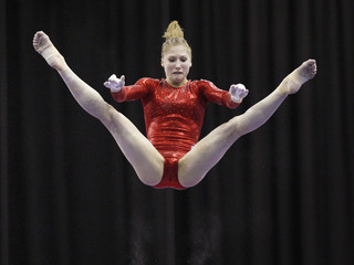 Russia's Kurbatova performs on the uneven bars during the senior women's Team Final in the European Artistic Gymnastics Championships in Birmingham