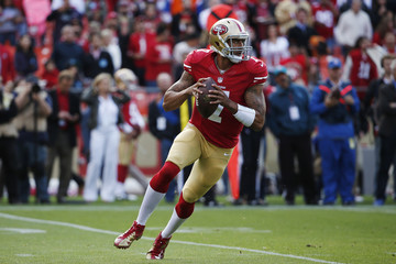 San Francisco 49ers' Kaepernick looks to pass the ball during their NFL pre-season football game against Denver Broncos in San Francisco