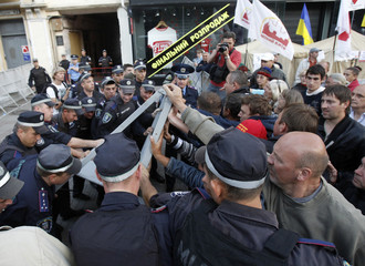 Ukrainian Interior Ministry personnel block supporters of former Ukrainian Prime Minister Tymoshenko during a protest rally outside the Pecherskiy District Court in Kiev