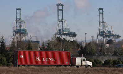 "A truck rolls past idle Port of Portland's cranes after ""Occupy Portland's"" attempt to shut down west coast ports in Oregon"