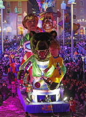 A float with giant figures of German Chancellor Angela Merkel and French President Francois Hollande parades during the Carnival parade in Nice