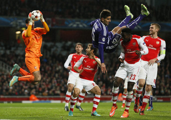 Arsenal's Welbeck challenges Anderlecht's Cyriac as Arsenal's goalkeeper Szczesny catches the ball during their Champions League soccer match at the Emirates stadium in London