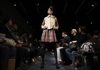 A model presents a creation by Japanese designer Junya Tashiro for 2010-2011 Autumn/Winter collection at Japan Fashion Week in Tokyo