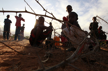 Newly arrived refugee families from Baidoa in Somalia camp with their belongings outside Ifo refugee camp in Dadaab