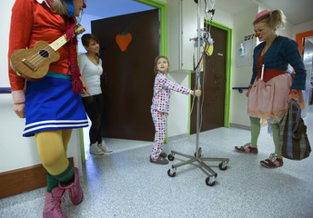 Girl looks at Belgian clowns at the pediatric department of the Hopital Erasme at the ULB in Brussels