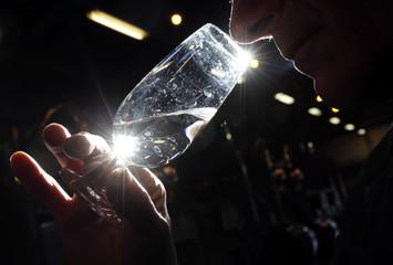 "A technical expert tastes the distillate, the ""eau de vie"", during a double distillation process in the distillery of Courvoisier cognac house in Cognac"