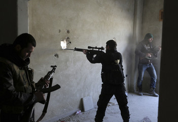A fighter from the Free Syrian Army's Tahrir al Sham brigade aims his rifle in Mleha suburb of Damascus