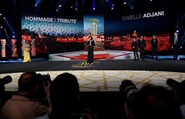 French actress Isabelle Adjani receives an award during an event to pay tribute to her during the 16th Marrakech International Film Festival in Marrakech