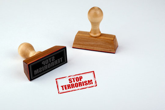Stop terrorism rubber stamper with wooden handle Isolated on white background