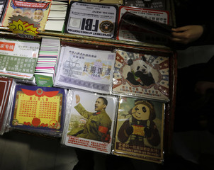 A mouse pad bearing an image of U.S. President Barack Obama dressed in Chinese Communist costume is displayed at a shop in Beijing