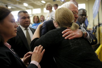 U.S. Democratic presidential candidate Senator Sanders gets a hug from supporter at a campaign rally in Berea