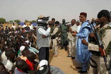 Bazoum speaks to people at the Boudouri site for displaced persons, outside the town of Diffa