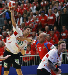 Norway's Kjelling attempts to score next to Russia's Igropulo and Norway's Lund during their Men's European Handball Championship group A match in Graz