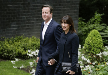 Britain's Prime Minister David Cameron and his wife Samantha arrive at Downing Street in London