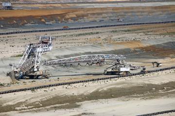 excavator digging on open pit coal mine
