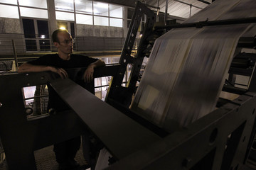 A pressman checks a rotary press at the printing presses owned by Algeria's Al Khabar and El Watan newspapers in Algiers