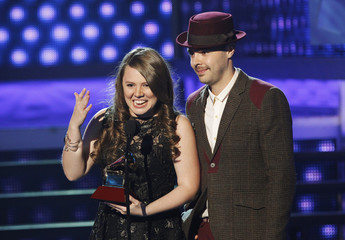 "Jesse & Joy accept award for record of the year for ""Corre!"" during the 13th Latin Grammy Awards in Las Vegas"