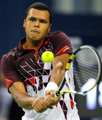 Jo-Wilfried Tsonga of France hits a shot during his match against Kei Nishikori of Japan at the Shanghai Masters tennis tournament