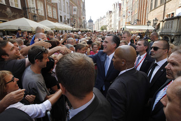 U.S. Republican Presidential candidate Mitt Romney meets with locals gathered outside the Old Town Hall in Gdansk