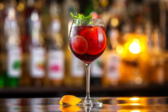 Closeup glass of red wine  fresh sangria at bright bar counter background.