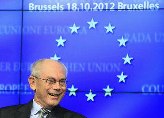 European Council President Herman Van Rompuy smiles at a news conference after a tripartite social meeting ahead of a two-day European Union leaders summit in Brussels
