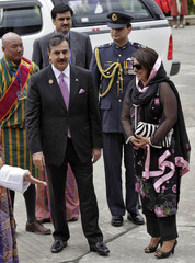 Pakistan's PM Gilani arrives with his Fauzia to attend 16th SAARC summit in Thimphu