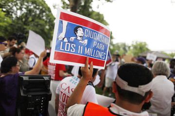 A group of immigrants and activists for immigration reform gather to march to urge congress to act on immigration reform, on Capitol Hill in Washington