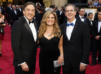 """Producers Chris Buck, Jennifer Lee and Peter Del Vecho, best animated feature film nominees for """"Frozen"""" arrive at the 86th Academy Awards in Hollywood"""