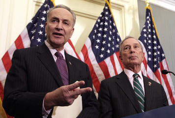 Senator Charles Schumer (D-NY) speaks next to New York City Mayor Michael Bloomberg at a joint news conference in Washington