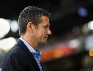 Olympique Lyon's coach Garde attends their match against Reims at the Gerland stadium in Lyon