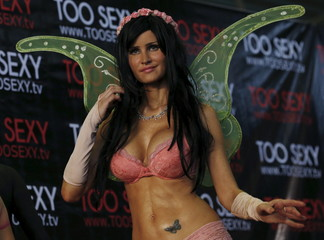 """An exotic dancer performs at the """"Sex and Entertainment Expo"""" adult exhibition at the Palacio de los Deportes in Mexico City"""