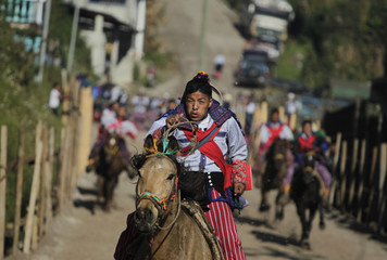 A rider competes in the annual horse race commemorating the Day of the Dead on All Saints Day at the village of Todos Los Santos Cuchumatan in the Huehuetenango region