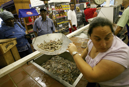 Chandra Chifici at Deanie's Seafood weighs shrimp for customers in Metairie