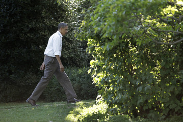 President Barack Obama walks to the Oval Office of the White House