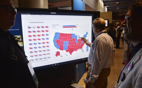 A delegate looks at an electoral map at the Democratic National Convention in Philadelphia