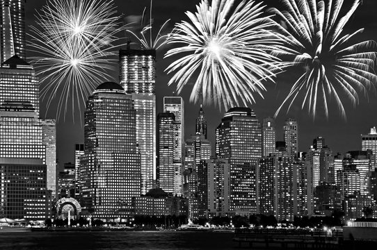 New York Manhattan skyline at night, with fireworks, american US celebration and party, black and white image