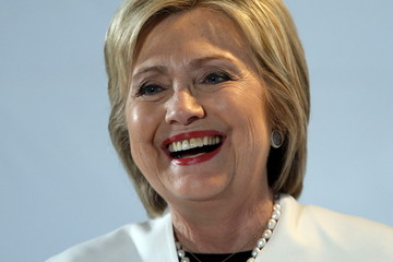Clinton smiles as she takes part in an onstage interview at the BET Networks Leading Women Defined program in Bal Harbour, Florida