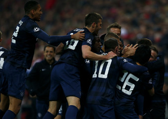 Manchester United's players celebrate a goal by Evra against Bayern Munich during their Champions League quarter-final second leg soccer match in Munich