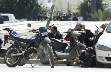 Police officers are seen on the pavement outside parliament in Tunis
