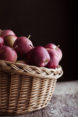 Red apples on wooden background