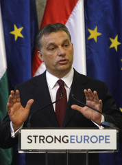 Hungary's Prime Minister Orban gestures at the press conference with European Commission President Barroso at Parliament in Budapest