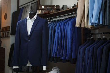 Stylish men's suit. Men's jacket on a mannequin. Men's Clothing. Mannequins in the window of the boutique. Clothing store. Shopping in boutiques.