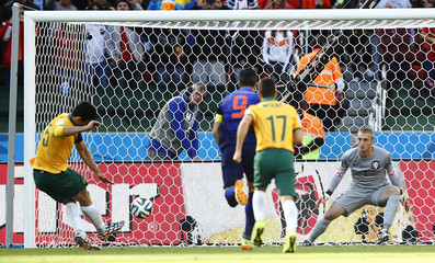 Australia's Jedinak sends Cillessen of the Netherlands the wrong way for a goal as he takes his penalty during their 2014 World Cup Group B soccer match at the Beira Rio stadium in Porto Alegre