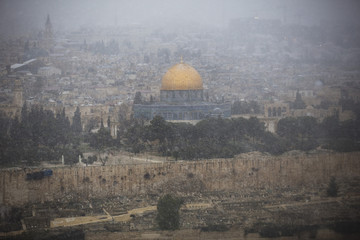 The Dome of the Rock is seen in Jerusalem's Old City during a snow storm