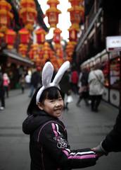 A girl wears bunny ears as she visits the Yuyuan Garden in downtown Shanghai
