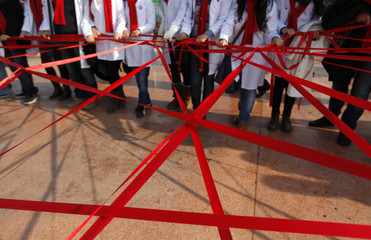 Medical students form a red ribbon, the symbol of the worldwide campaign against AIDS, during an HIV/AIDS awareness rally on World AIDS Day in central Istanbul