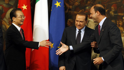 Italy's Minister of Justice Alfano shakes hands with China's Premier Wen as Italy's Prime Minister Berlusconi looks on at Palazzo Chigi in Rome